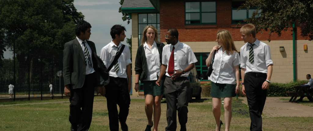 Worker walking with Students