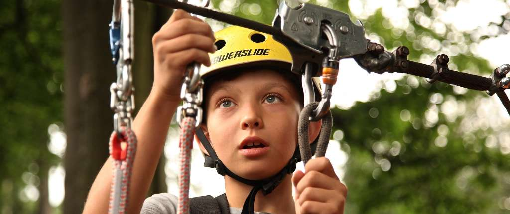 Boy on climbing ropes