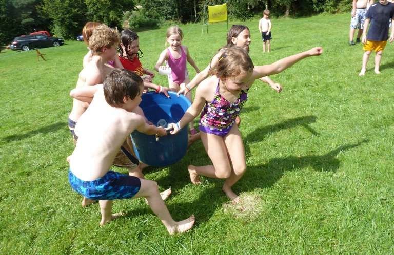 Group of Children with Bucket of Water - Summer Fun