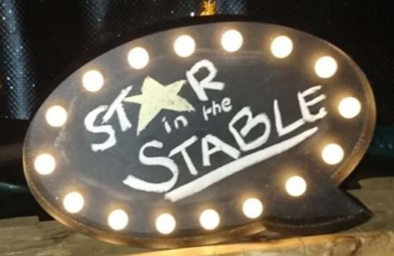 Star in the stable sign