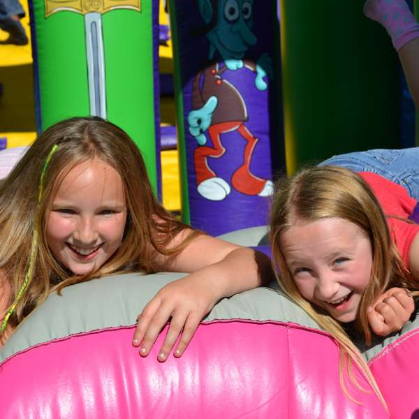 Two girls on a bouncy castle
