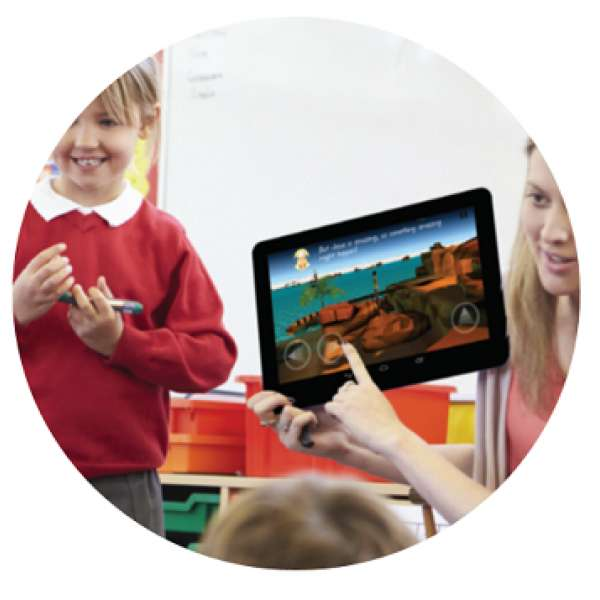 A child and teacher looking at a tablet